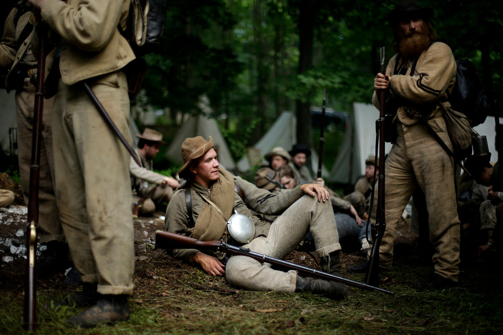 . Members of the 1st Tennessee wait to take part in in a demonstration of a battle during ongoing activities commemorating the 150th anniversary of the Battle of Gettysburg, Friday, June 28, 2013, at  at Bushey Farm in Gettysburg, Pa.  Union forces turned away a Confederate advance in the pivotal battle of the Civil War fought July 1-3, 1863, which was also the warís bloodiest conflict with more than 51,000 casualties. (AP Photo/Matt Rourke)