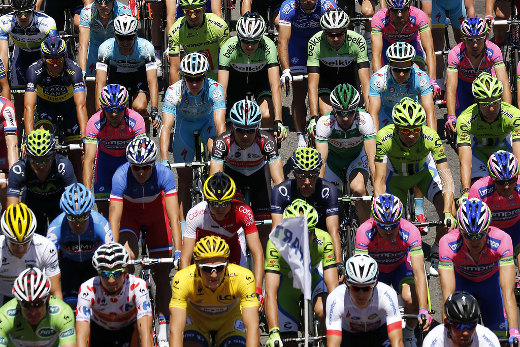 . The pack rides during the 156 km second stage of the 100th edition of the Tour de France cycling race on June 30, 2013 between Bastia and Ajaccio, on the French Mediterranean Island of Corsica.     JOEL SAGET/AFP/Getty Images