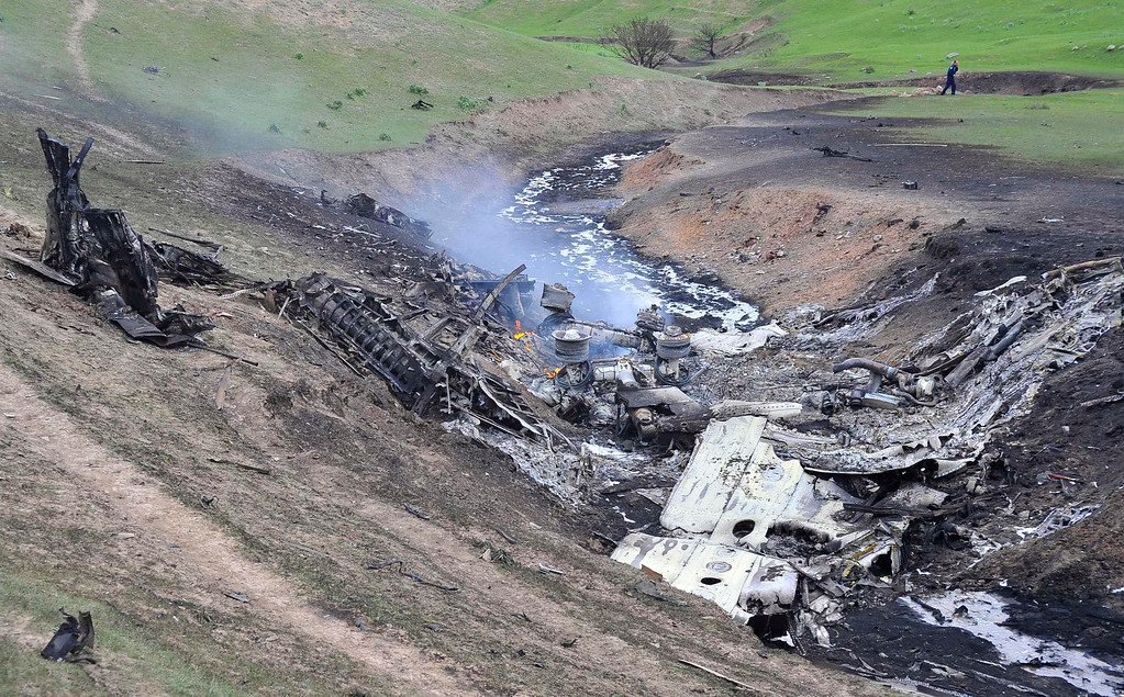 . A general view shows the site of the Boeing KC-135 Stratotanker plane crash, near the Kyrgyz village of Chaldovar, May 3, 2013.REUTERS/Sabyr Alichiev/Pool