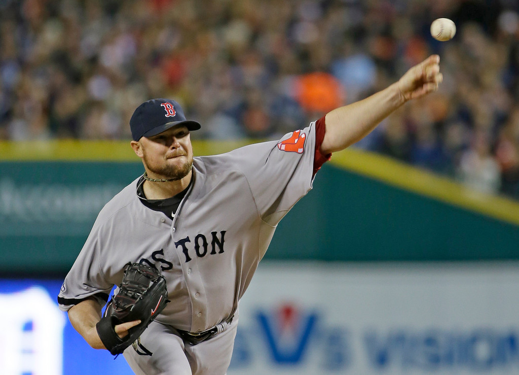 . Boston Red Sox starting pitcher Jon Lester throws in the first inning during Game 5 of the American League baseball championship series against the Detroit Tigers  Thursday, Oct. 17, 2013, in Detroit. (AP Photo/Matt Slocum)