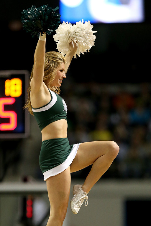 . AUBURN HILLS, MI - MARCH 23:  Cheerleaders for the Michigan State Spartans perform against the Memphis Tigers during the third round of the 2013 NCAA Men\'s Basketball Tournament at The Palace of Auburn Hills on March 23, 2013 in Auburn Hills, Michigan.  (Photo by Jonathan Daniel/Getty Images)
