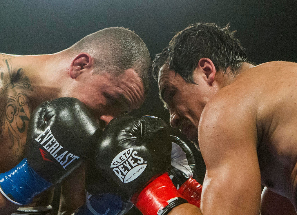 . Mike Alvarado, left, and Juan Manuel M·rquez, of Mexico, eye each other in the fifth round of a WBO welterweight title boxing match at the Forum in Inglewood, Calif., Saturday, May 17, 2014. M·rquez won the title.  (AP Photo/Ringo H.W. Chiu)