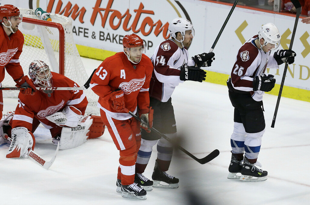 . Colorado Avalanche center Paul Stastny (26) reacts after scoring on Detroit Red Wings goalie Jimmy Howard (35) during the third period of an NHL hockey game in Detroit, Tuesday, March 5, 2013. Detroit won 2-1. (AP Photo/Carlos Osorio)