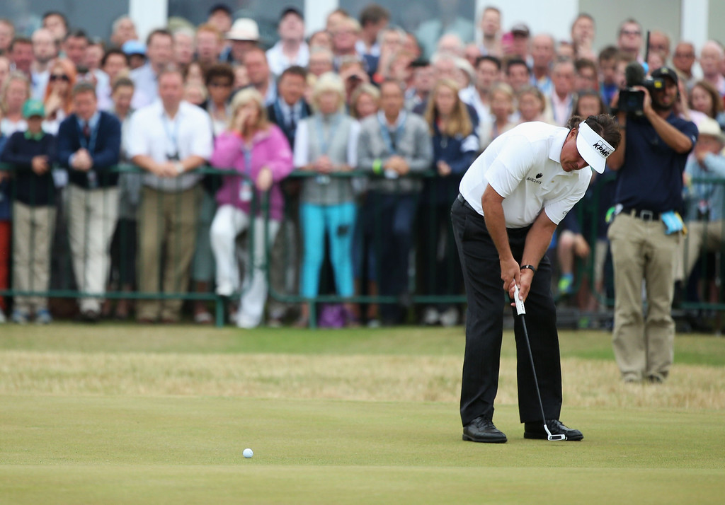 . Phil Mickelson of the United States makes a birdie putt on the 18th green during the final round of the 142nd Open Championship at Muirfield on July 21, 2013 in Gullane, Scotland.  (Photo by Andy Lyons/Getty Images)