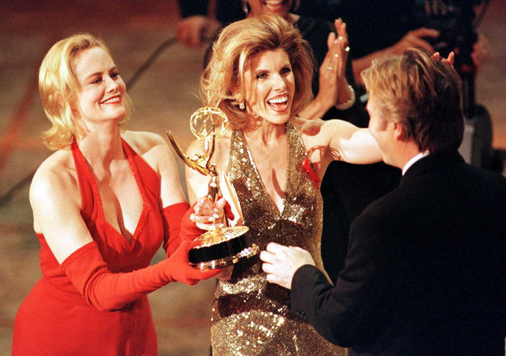 ". Actresses Cybill Shepherd (L) and Christine Baranski (C) present an Emmy to Alan Rickman (R) for outstanding lead actor in a mini-series or special for his lead role in the HBO production of ""Rasputin\"" during the 48th Annual Emmy Awards 08 September in Pasadena, California. (Vince Bucci/AFP/Getty Images)"