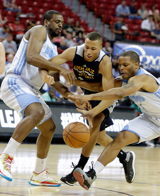 . Utah Jazz\'s Dante Exum, center, reaches for a loose ball with Denver Nuggets\' Will Thomas, left, and Chris Wright during the first half of an NBA summer league basketball game Tuesday, July 15, 2014, in Las Vegas. (AP Photo/Isaac Brekken)