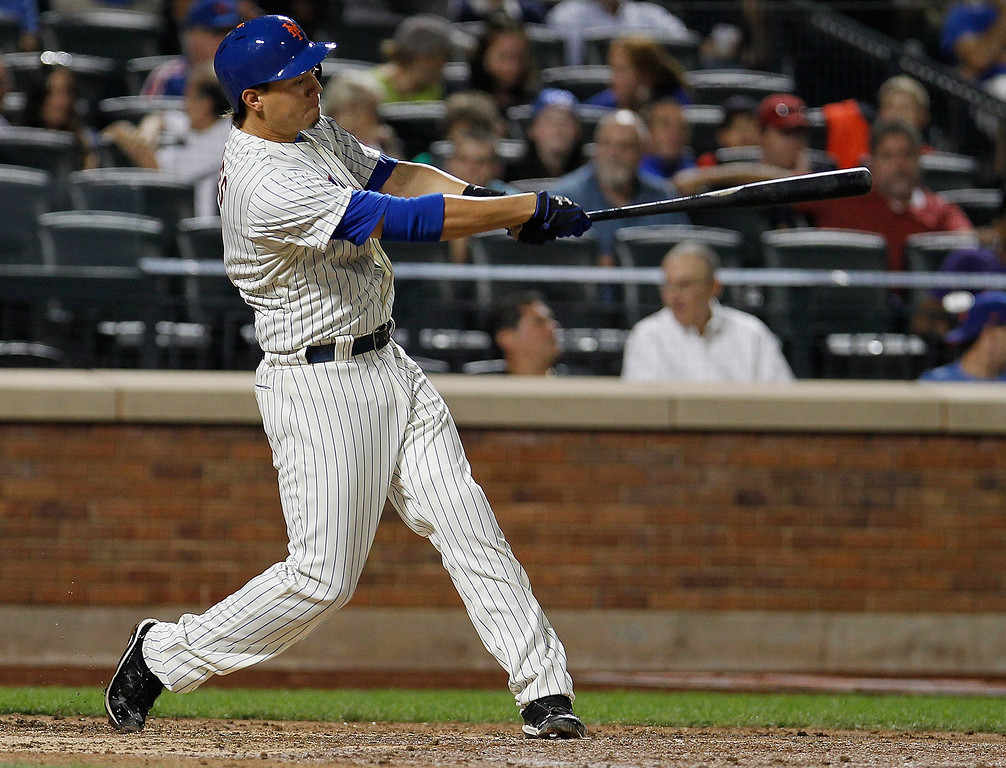 . Wilmer Flores #4 of the New York Mets flies out to left in the fourth inning against the Colorado Rockies at Citi Field on August 6, 2013 at Citi Field in the Flushing neighborhood of the Queens borough of New York City.  (Photo by Mike Stobe/Getty Images)