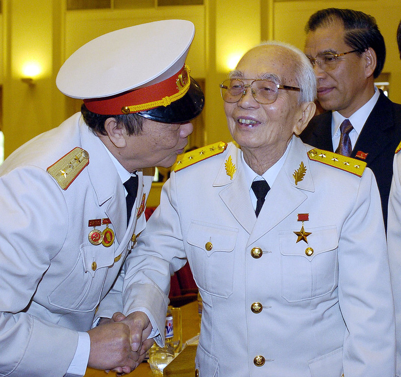 """. File photo dated December 20, 2004 in Hanoi shows retired legendary Vietnamese 94-year-old  General Vo Nguyen Giap (C) greeted by an unidentified general as he arrives to attend a meeting to mark the 60th anniversary of the foundation of Vietnamese armed forces. General Giap, who was Vietnam\'s Defense Minister during wars that defeated French and American forces, died October 4, 2013 at the age of 102. US Senator and former prisoner of war John McCain said October 7, 2013 that Vietnam\'s willingness to suffer \""""immense casualties\"""" was the linchpin in legendary General Vo Nguyen Giap\'s defeat of American forces. Hours after the news of Giap\'s death, McCain in a brief tweet praised the legendary general as a \""""brilliant military strategist\"""" who once called the United States an honorable enemy. But in a Wall Street Journal op-ed, McCain called into question the morality of the Vietnamese tactic, which he said Giap executed with an \""""unbending will.\""""  AFP PHOTOSTR/AFP/Getty Images"""