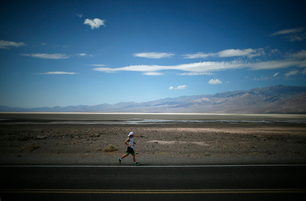 . A runner competes in the Badwater Ultramarathon in Death Valley National Park, California July 15, 2013. The 135-mile (217 km) race, which bills itself as the world\'s toughest foot race, goes from Death Valley to Mt. Whitney, California in temperatures which can reach 130 degrees Fahrenheit (55 Celsius).  REUTERS/Lucy Nicholson
