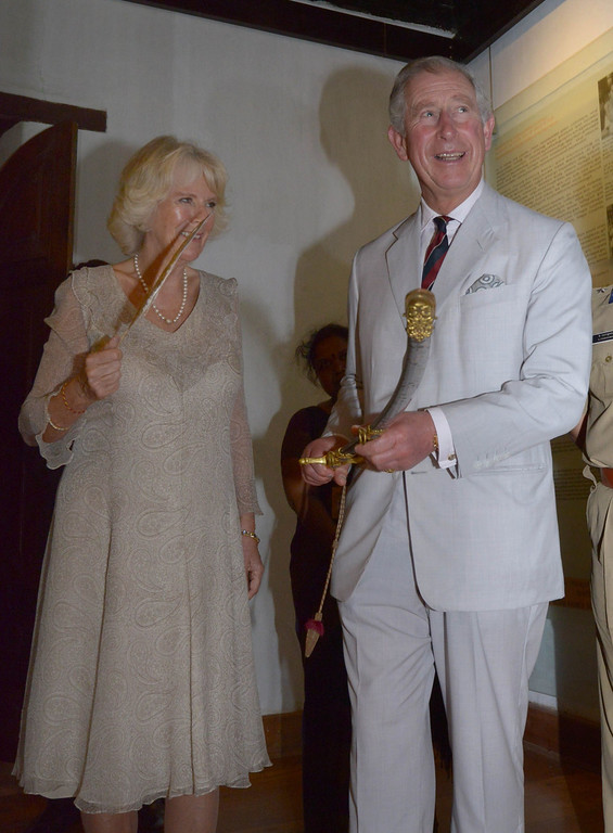 . In this handout photograph released by The Kerala Press and Information Department on November 14, 2013, Britain\'s Prince Charles (R) shares a light moment with Camilla, Duchess of Cornwall as he holds a sword sword given by the then Prince of Wales in 1875 to King Raja RajaVarma during a visit to The Mattancherry Dutch Palace Museum in Kochi on November 14, 2013.     KERALA PRESS INFORMATION DEPARTMENTAFP/Getty Images