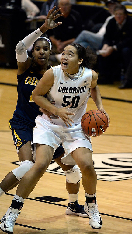 . Colorado Buffaloes forward Jamee Swan (50) drives on California Golden Bears forward Reshanda Gray (21) during the second half Sunday, January 6, 2013 at Coors Events Center. John Leyba, The Denver Post
