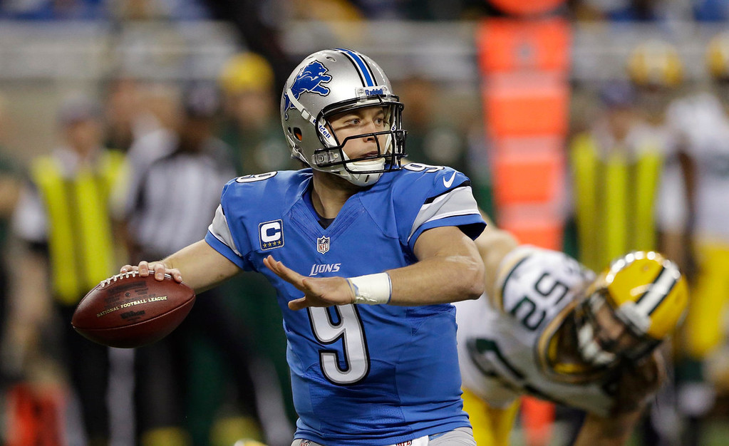 . Detroit Lions quarterback Matthew Stafford (9) throws during the first quarter of an NFL football game against the Green Bay Packers at Ford Field in Detroit, Thursday, Nov. 28, 2013. (AP Photo/Carlos Osorio)