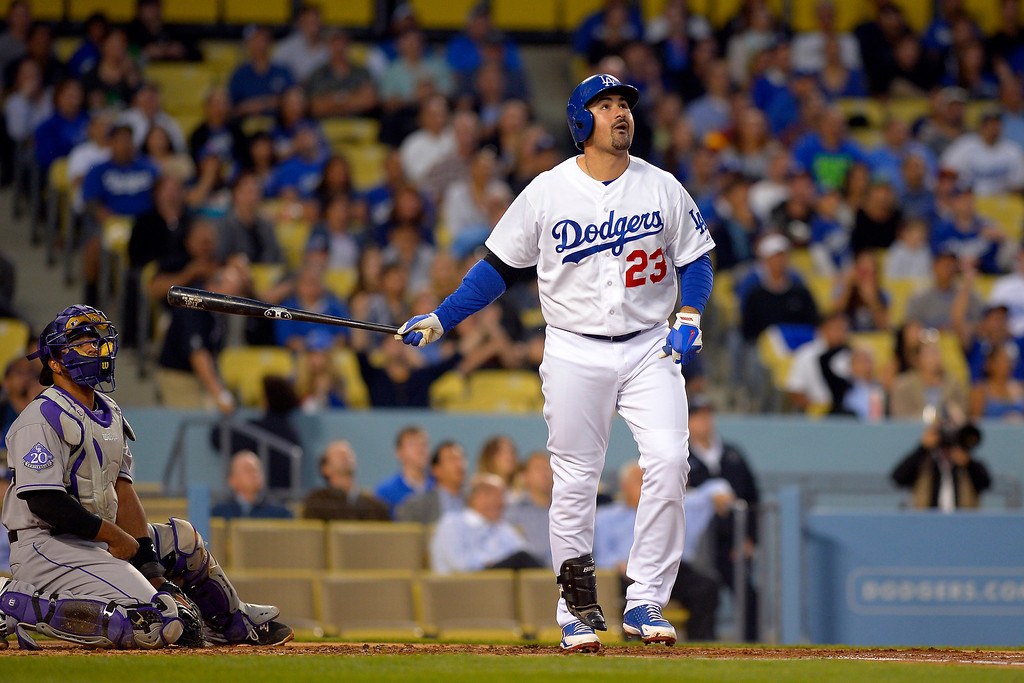 . Los Angeles Dodgers\' Adrian Gonzalez, right, watches his ball go out or a two-run home run as Colorado Rockies catcher Wilin Rosario looks on during the first inning of their baseball game, Wednesday, May 1, 2013, in Los Angeles. (AP Photo/Mark J. Terrill)