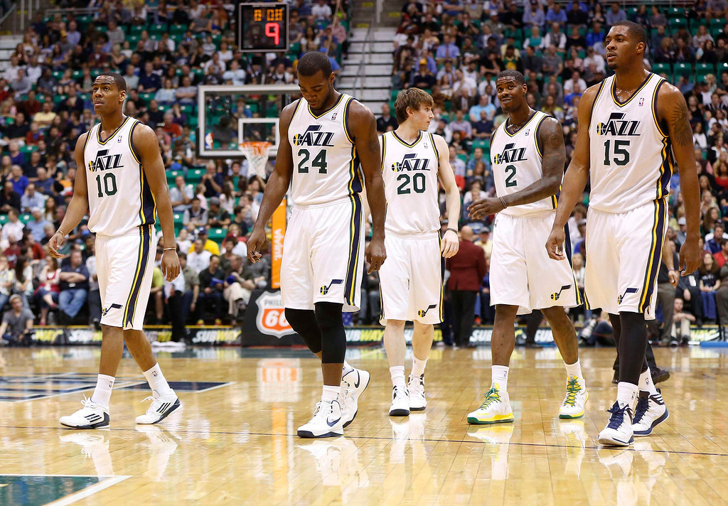 . Utah Jazz\'s (L-R) Alec Burks, Paul Millsap, Gordon Hayward, Marvin Williams and Derrick Favors walk onto the court after a timeout during the first half of their NBA basketball game against the Denver Nuggets in Salt Lake City, Utah April 3, 2013. REUTERS/Jim Urquhart