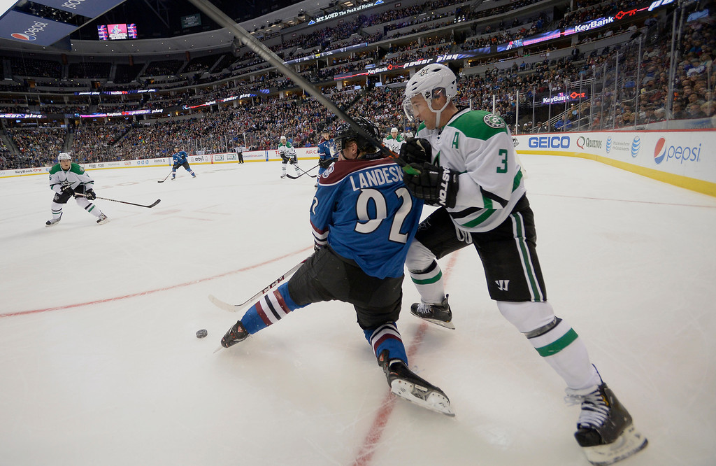 . DENVER, CO - OCTOBER 15: Colorado Avalanche left wing Gabriel Landeskog (92) battles with Dallas Stars defenseman Stephane Robidas (3) for the puck during the first period October 15, 2013 at Pepsi Center.(Photo By John Leyba/The Denver Post)