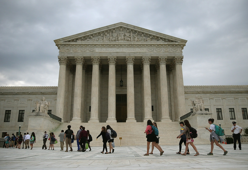 . People arrive to attend the final session of the term at the U.S. Supreme Court on June 30, 2014 in Washington, DC.  (Photo by Mark Wilson/Getty Images)