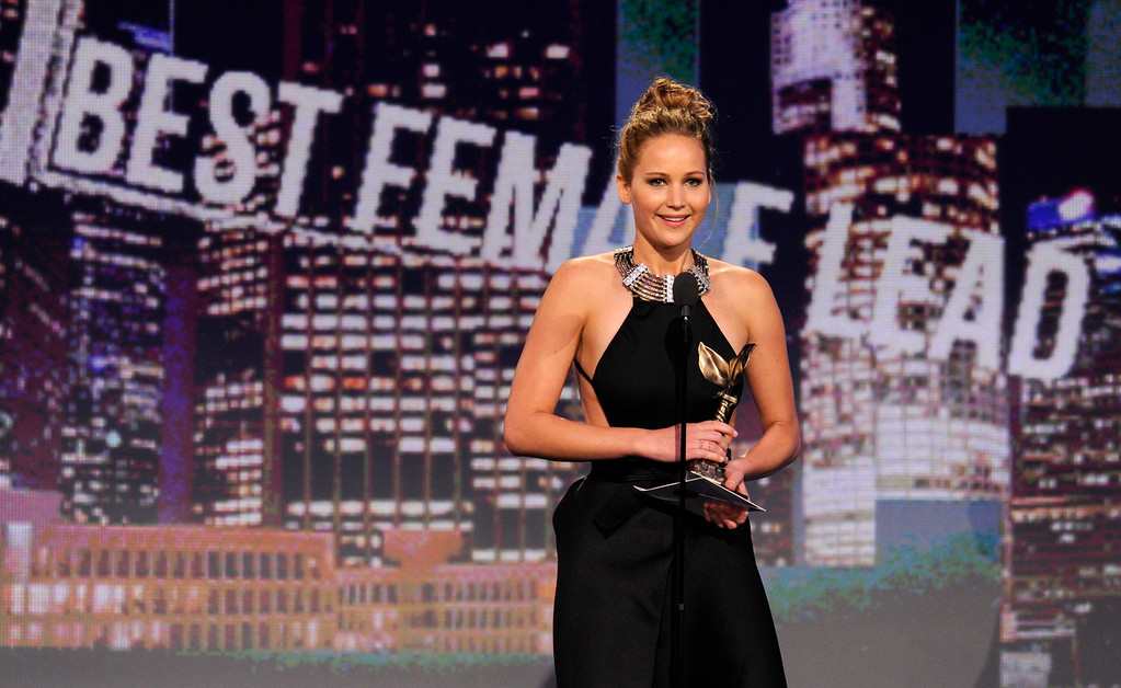 ". Actress Jennifer Lawrence accepts the award for best female lead for ""Silver Linings Playbook\"" at the Independent Spirit Awards on Saturday, Feb. 23, 2013, in Santa Monica, Calif. (Photo by Chris Pizzello/Invision/AP)"