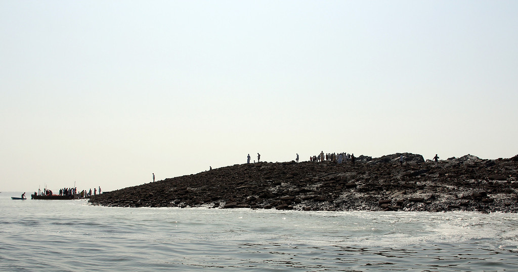 . This photograph taken on September 25, 2013, shows Pakistani residents as they arrive by boat to an island that appeared some two kilometres off the coastline at Gwadar after an earthquake. A small island of mud and rock created by the huge earthquake that hit southwest Pakistan has fascinated locals but experts -- who found methane gas rising from it -- say it is unlikely to last long. The 7.7-magnitude quake struck on September 24, in Baluchistan\'s remote Awaran district, killing at least 271 people and affecting hundreds of thousands. BEHRAM BALOCH/AFP/Getty Images