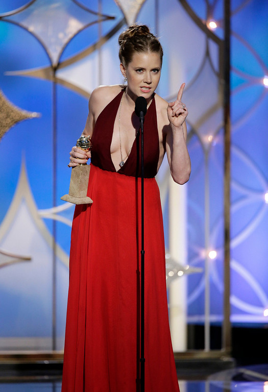 ". This image released by NBC shows Amy Adams accepting the award for best actress in a motion picture, musical or comedy for her role in, ""American Hustle\""  during the 71st annual Golden Globe Awards at the Beverly Hilton Hotel on Sunday, Jan. 12, 2014, in Beverly Hills, Calif. (AP Photo/NBC, Paul Drinkwater)"