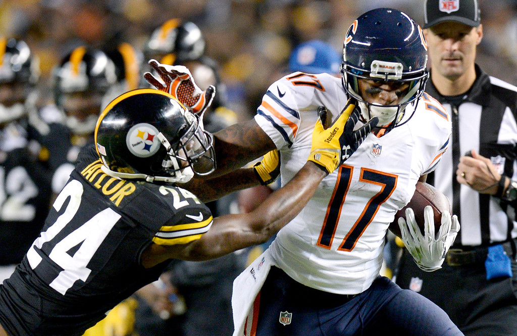 . Chicago Bears wide receiver Alshon Jeffery (17) is hit by Pittsburgh Steelers cornerback Ike Taylor (24) after making a catch in the third quarter of an NFL football game on Sunday, Sept. 22, 2013, in Pittsburgh. (AP Photo/Don Wright)