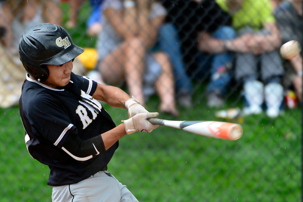 . LAKEWOOD, CO - MAY 23: Justin Akiyama makes the game-winning hit in the 7th inning to win the game for Green Mountain. The Durango Demons take on the Green Mountain Rams in the 4A Baseball State Semi-Final Championships. (Kathryn Scott Osler, The Denver Post)