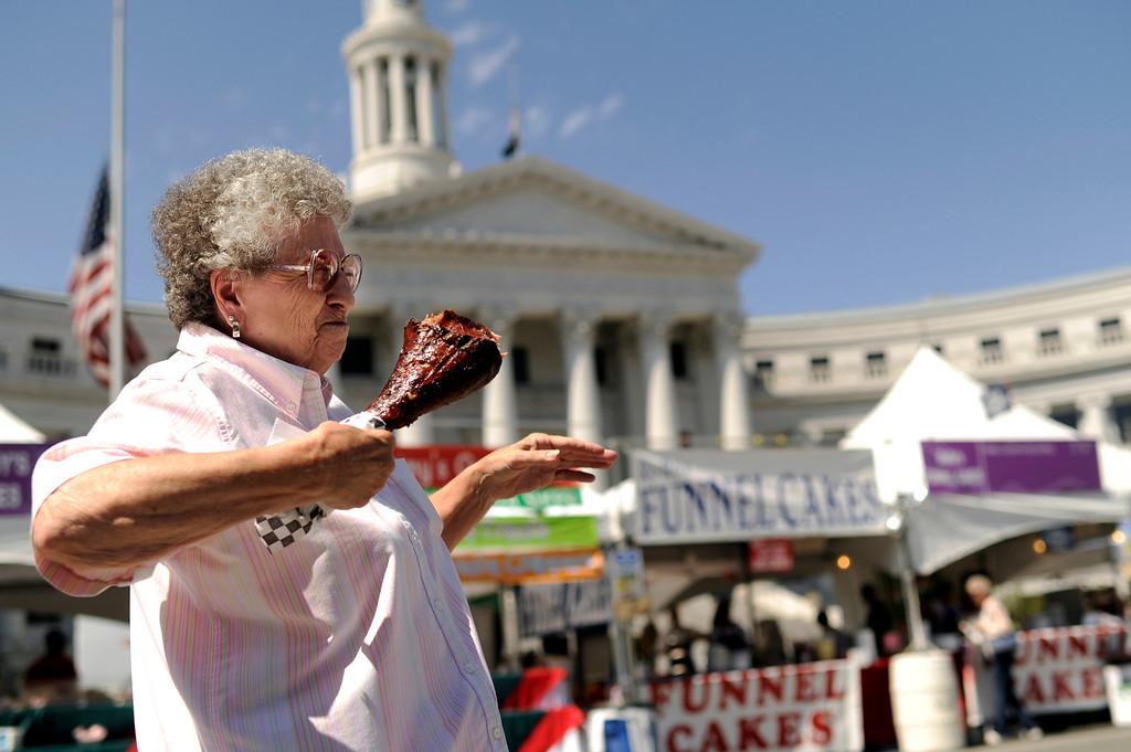 . Margaret Solt, 78. of Denver enjoys the Turkey Leg at Tase of Colorado indowntown in Denver, CO. Friday, August 31, 2012.  Hyoung Chang, The Denver Post