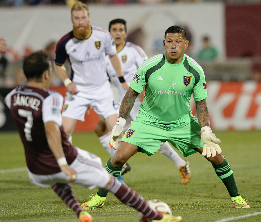 . COMMERCE CITY, CO - AUGUST 2: Colorado forward Vicente Sanchez challenged Salt Lake goalie Nick Rimando in the second half. Real Salt Lake defeated the Colorado Rapids 1-0 at Dick\'s Sporting Goods Park Saturday night, August 2, 2014.  Photo by Karl Gehring/The Denver Post