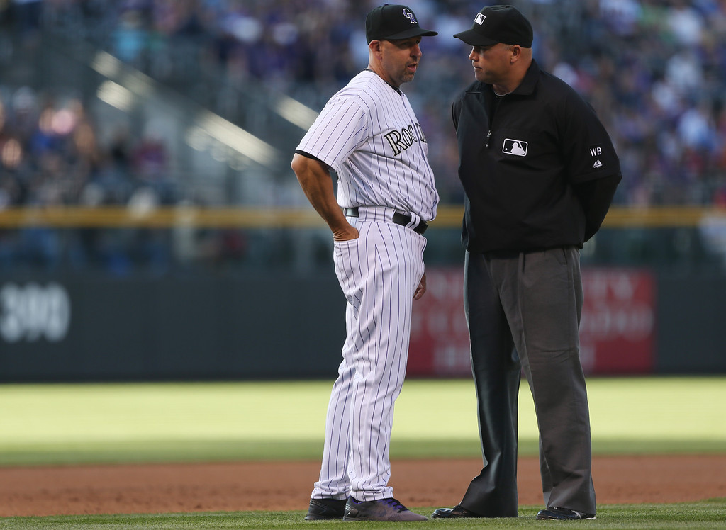 . Colorado Rockies manager Walt Weiss, left, asks for instant replay decision on a play at third base with umpire Mark Carlson in the first inning of a baseball game against the New York Mets in Denver, Saturday, May 3, 2014. The umpires found that Mets\' Anthony Recker was safe at third as he advanced on a single by Lucas Duda. (AP Photo/David Zalubowski)