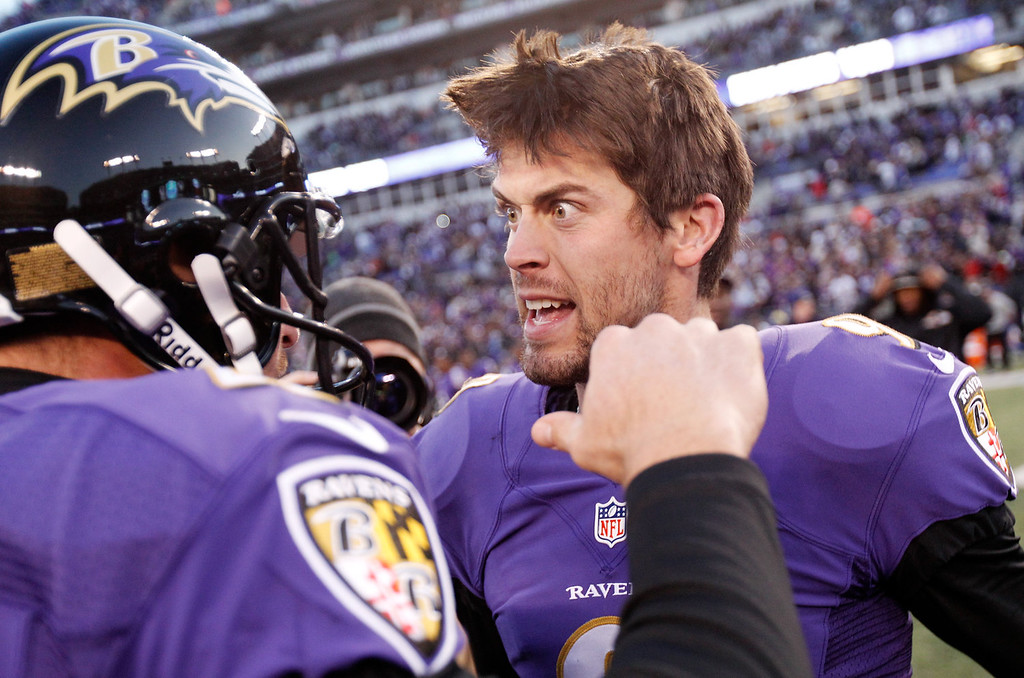 . Kicker Justin Tucker #9 of the Baltimore Ravens (R) celebrates with holder Sam Koch #4 after hitting the game winning kick in overtime to give the Ravens a 20-17 win over the Cincinnati Bengals  at M&T Bank Stadium on November 10, 2013 in Baltimore, Maryland.  (Photo by Rob Carr/Getty Images)