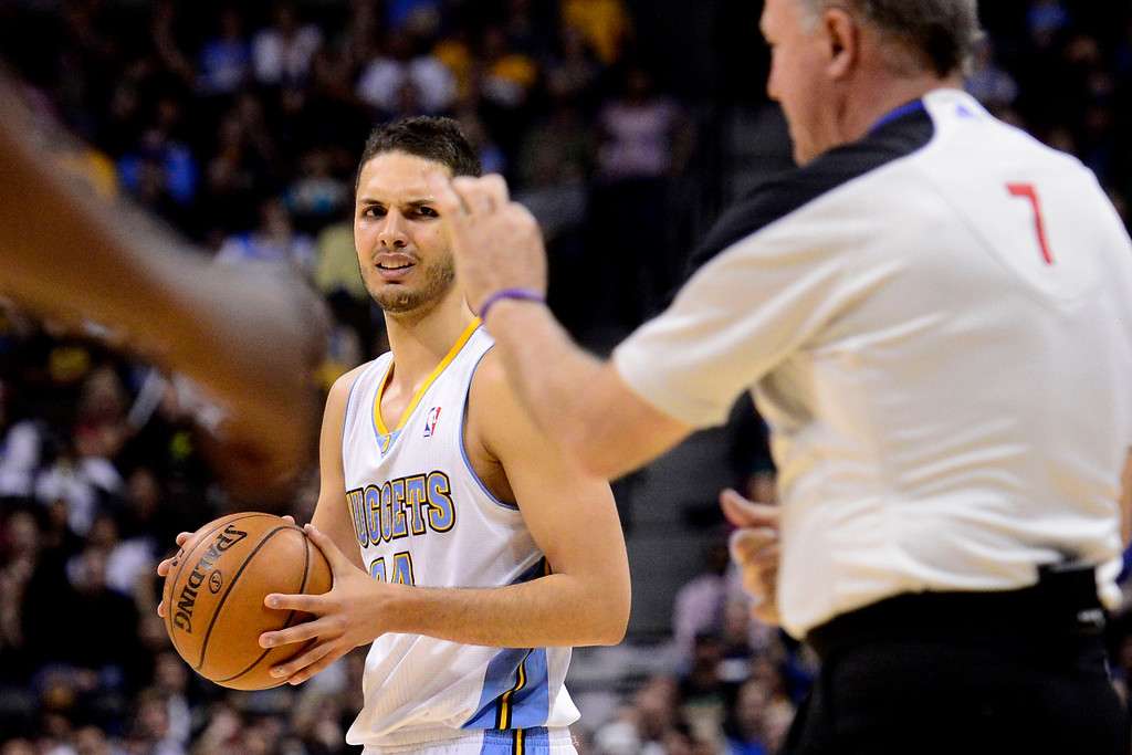 . DENVER, CO - APRIL 14: Evan Fournier (94) of the Denver Nuggets looks at the referee after teammate Ty Lawson (3) was called for a foul during the second half of action. The Denver Nuggets defeat the Portland Trail Blazers 118-109 at the Pepsi Center. (Photo by AAron Ontiveroz/The Denver Post)