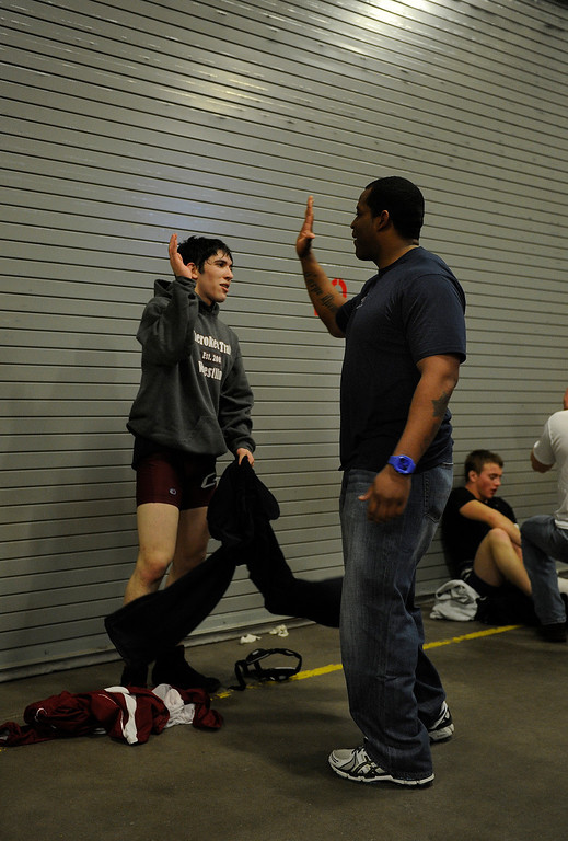 . DENVER, CO. - FEBRUARY 21: Cherokee Trail coach Jamal Lewis, right, congratulated senior Jalen Reyes after a win in the 160-pound division Friday afternoon. The CHSAA State Wrestling Tournament continued Friday, February 22, 2013 with quarterfinal and semifinal matches at the Pepsi Center in Denver. (Photo By Karl Gehring/The Denver Post)