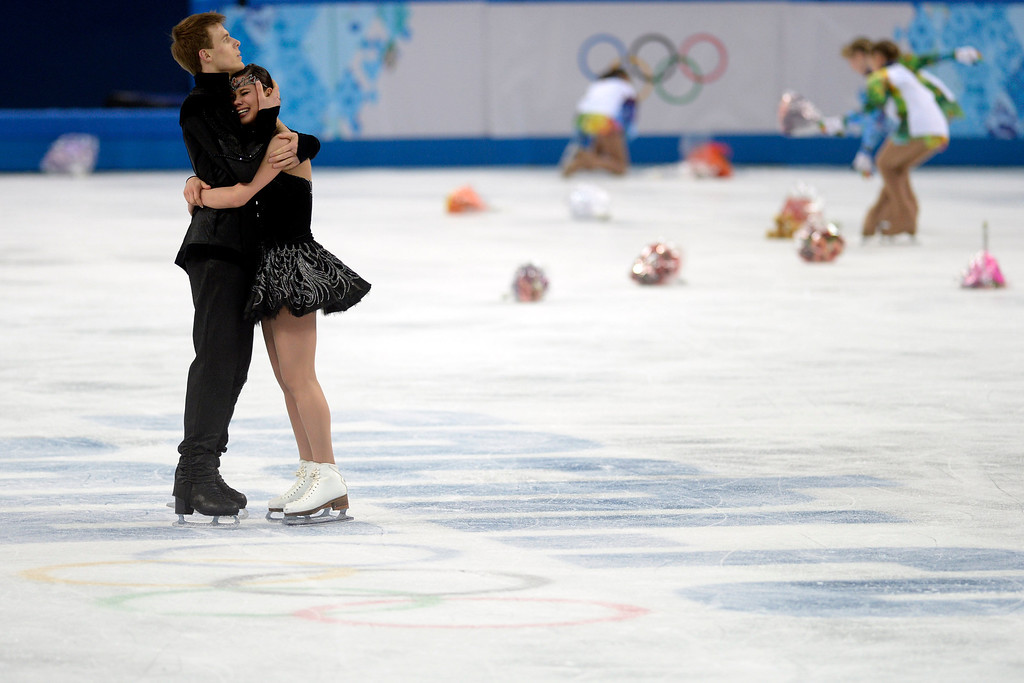 . Russian bronze medalists Nikita Katsalapov and Elena Ilinykh are overcome during the figure skating ice dancing free dance medal round. Sochi 2014 Winter Olympics on Monday, February 17, 2014. (Photo by AAron Ontiveroz/The Denver Post)