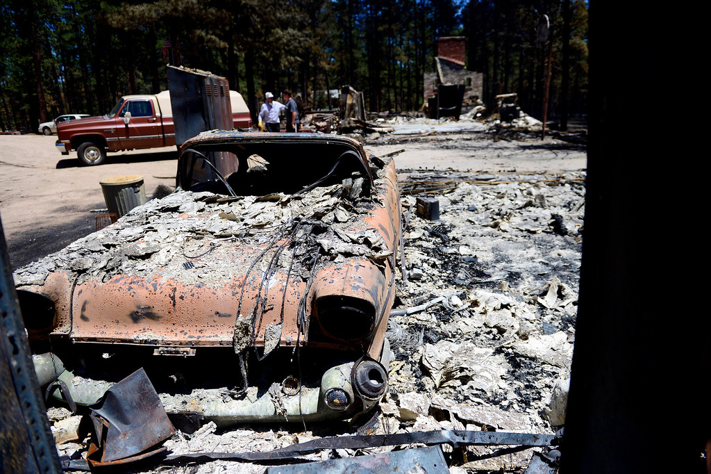 . BLACK FOREST, CO - JUNE 19: A 1957 Chevy was among the total losses at the home of Don and Vaneal Burgess after it was burned by the Black Forest Fire on Shoup Road. The couple owned the home for 35 years, raised their children and entertained their 13 grandchildren. Their daughter also lost her home to the Black Forest Fire near Herring Road. (Photo by AAron Ontiveroz/The Denver Post)