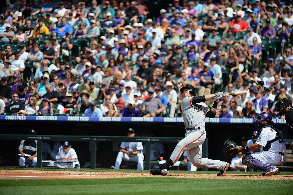. Buster Posey #28 of the San Francisco Giants hits a home run during the third inning of the game against the Colorado Rockies at Coors Field on June 30, 2013 in Denver, Colorado.  (Photo by Garrett W. Ellwood/Getty Images)