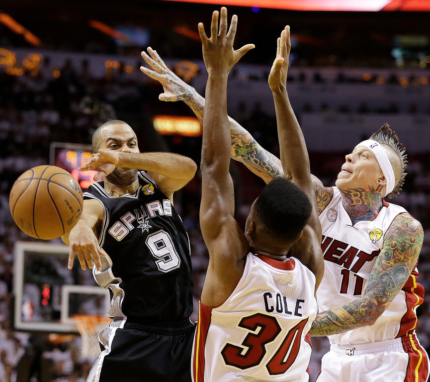 . San Antonio Spurs point guard Tony Parker (9) passes the ball against Miami Heat point guard Norris Cole (30) and Miami Heat power forward Chris Andersen (11) during the first half of Game 1 of basketball\'s NBA Finals, Thursday, June 6, 2013 in Miami. (AP Photo/Lynne Sladky)