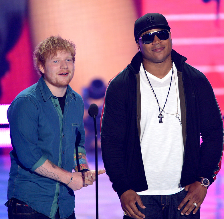 . Presenters Ed Sheeran, left, and LL Cool J speak on stage at the Teen Choice Awards at the Gibson Amphitheater on Sunday, Aug. 11, 2013, in Los Angeles.(Photo by John Shearer/Invision/AP)
