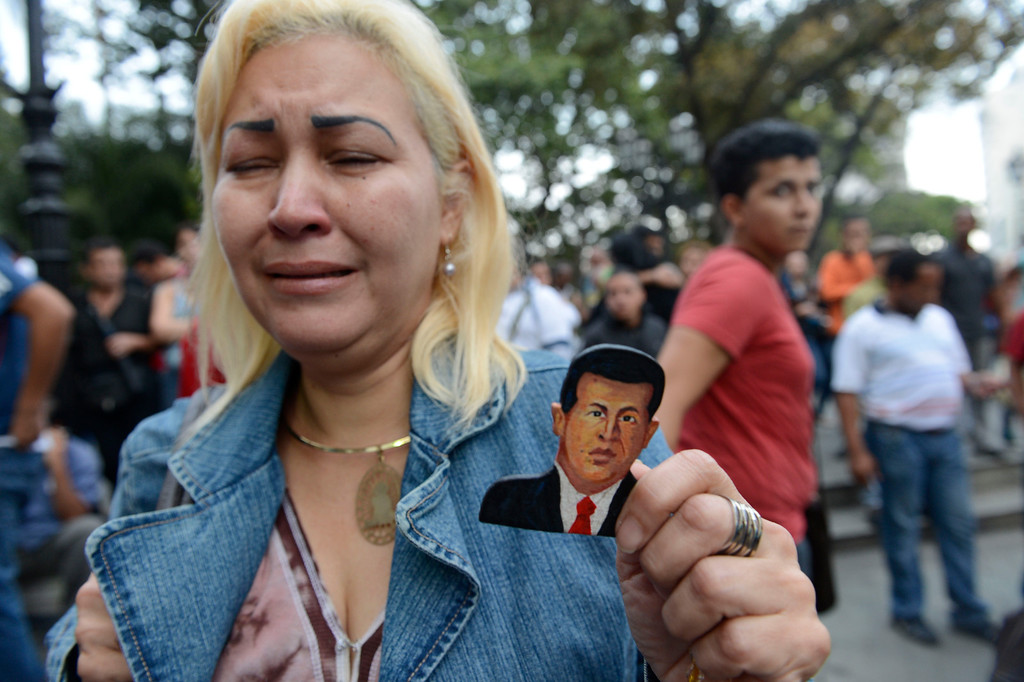 . A supporter of Venezuelan President Hugo Chavez cries after knowing of his death in Caracas on March 5, 2013.  JUAN BARRETO/AFP/Getty Images