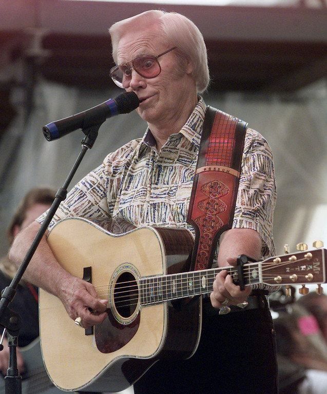 . Country music legend George Jones performs \'Sinners and Saints\' during the opening day of FanFair \'99 in Nashville, Tenn., on Monday, June 14, 1999. Three months after a life-threatening car crash, the country singer wowed fans on Monday, despite complaining he had trouble hitting low notes. \'I TOLD you I\'d be back,\' Jones said mischievously after finishing his first number, \'High-Tech Redneck,\' at a showcase of his record label, Asylum. (AP Photo/John Russell)