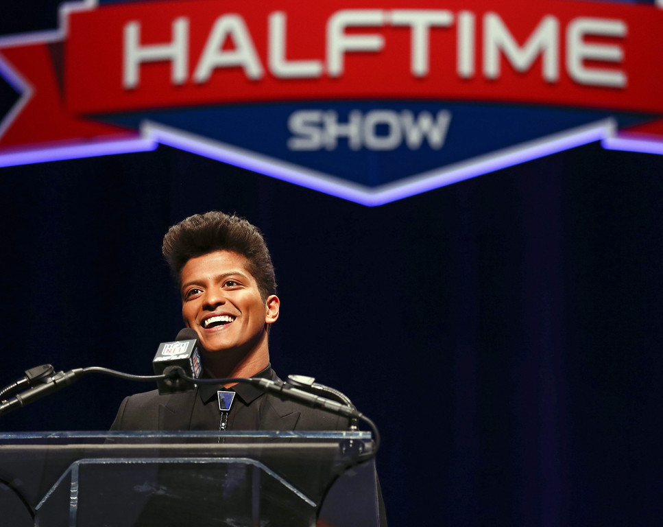 . U.S. pop artist Bruno Mars speaks at a news conference for the Super Bowl LXVIII in New York, New York, USA 30 January 2014.  EPA/TANNEN MAURY