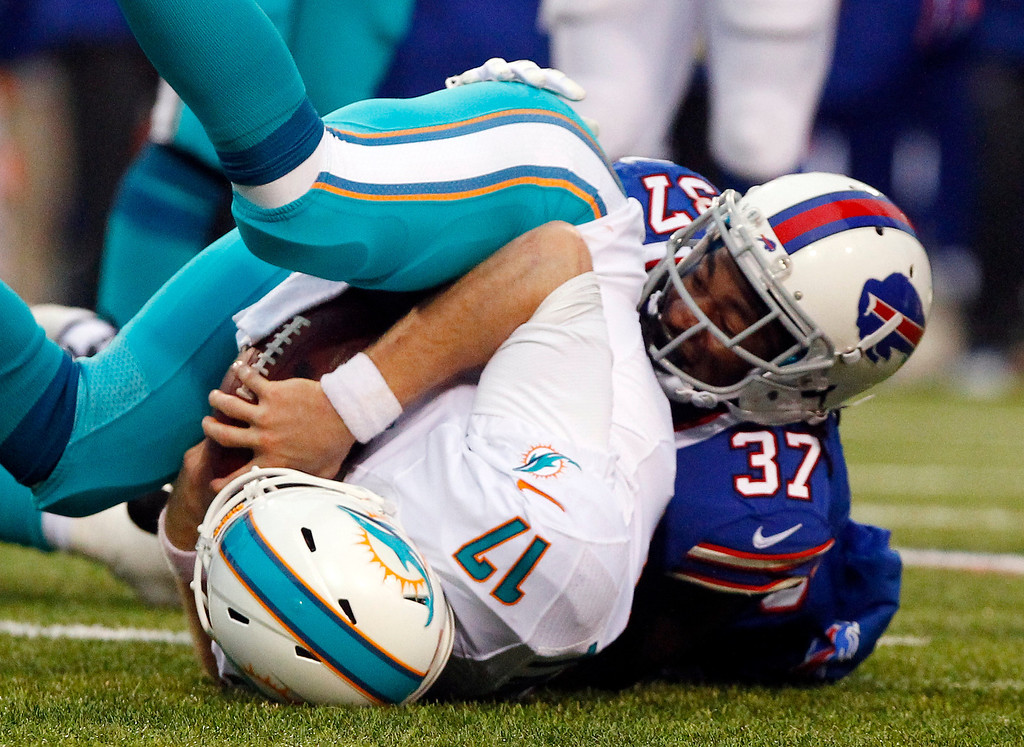 . Buffalo Bills defensive back Nickell Robey (37) sacks Miami Dolphins quarterback Ryan Tannehill (17) during the second half of an NFL football game on Sunday, Dec. 22, 2013, in Orchard Park, N.Y. Buffalo won 19-0. (AP Photo/Bill Wippert)
