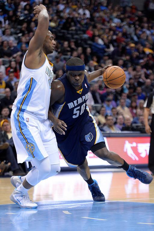 . Memphis Grizzlies forward Zach Randolph (50) drives on Denver Nuggets forward Darrell Arthur (00) during the third quarter of action. (Photo by AAron Ontiveroz/The Denver Post)