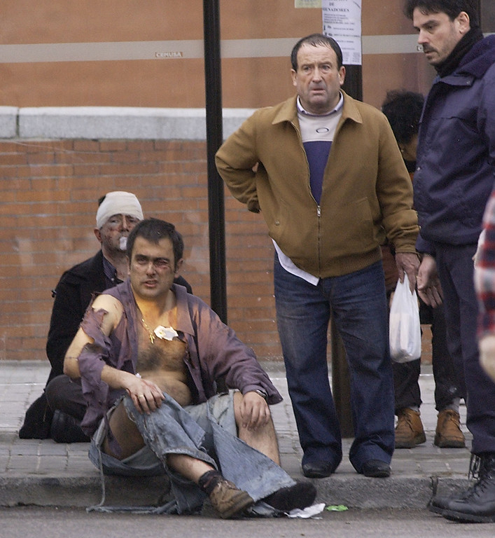 . Victims wait for assistance after a train exploded at the Atocha train station in Madrid 11 March 2004. At least 198 people were killed and more than 1400 wounded in bomb attacks on four commuter trains. RICARDO CASES/AFP/Getty Images