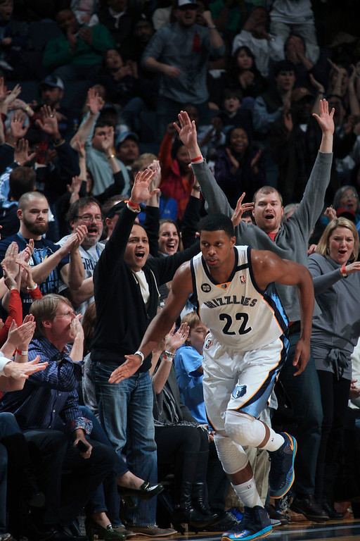 . Memphis Grizzlies forward Rudy Gay (22) celebrates his three-pointer with fans during the second half of their NBA game against the Denver Nuggets in Memphis, Tennessee December 29, 2012.  REUTERS/Nikki Boertman