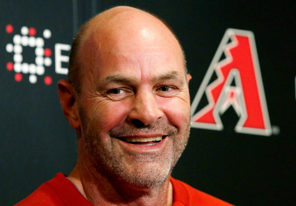 . Arizona Diamondbacks manager Kirk Gibson laughs as he talks with reporters a day prior to the start of baseball spring training for pitchers and catchers, at the Diamondbacks\' training facility Thursday, Feb. 6, 2014, in Scottsdale, Ariz. (AP Photo/Ross D. Franklin)