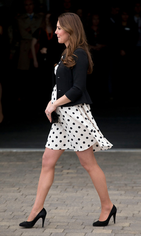 """. Kate the Duchess of Cambridge, her husband Prince William and his brother Prince Harry, both not pictured, leave after attending the inauguration of \""""Warner Bros. Studios Leavesden\"""" near Watford, approximately 18 miles north west of central London, Friday, April 26, 2013.(AP Photo/Matt Dunham)"""