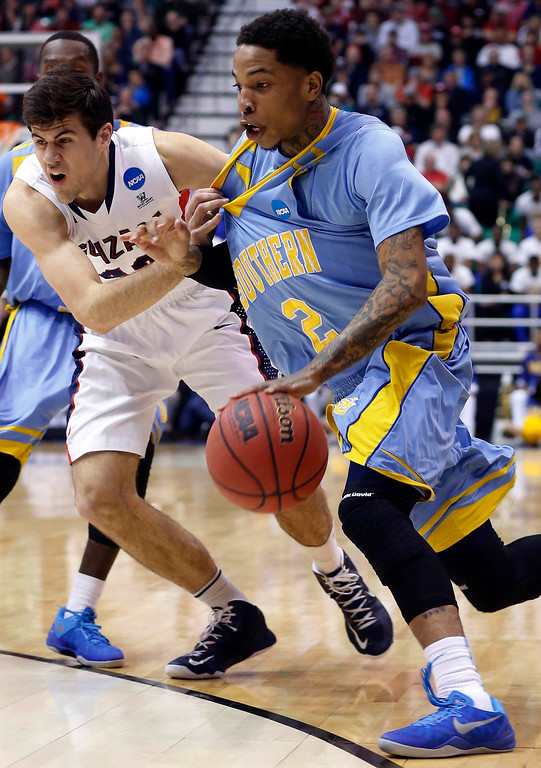. Southern University guard Derick Beltran (2) is defended by Gonzaga guard Drew Barham (43) during the first half of their second round NCAA tournament basketball game in Salt Lake City, Utah, March 21, 2013. REUTERS/Jim Urquhart