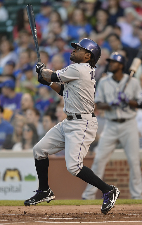 . Eric Young Jr. #1 of the Colorado Rockies hits a two-run home run, scoring teammate Josh Rutledge (not pictured) during the second inning against the Chicago Cubs on May 14, 2013 at Wrigley Field in Chicago, Illinois.    (Photo by Brian Kersey/Getty Images)