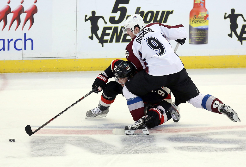 . Colorado Avalanche\'s Matt Duchene (9) checks Ottawa Senators\' Milan Michalek during third-period NHL hockey game action in Ottawa, Ontario, Sunday, March 16, 2014. (AP Photo/The Canadian Press, Fred Chartrand)