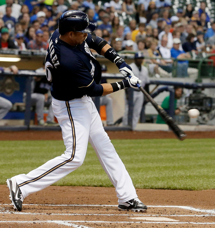. Milwaukee Brewers\' Aramis Ramirez hits a two-run home run during the first inning of a baseball game against the Colorado Rockies on Thursday, June 26, 2014, in Milwaukee. (AP Photo/Morry Gash)