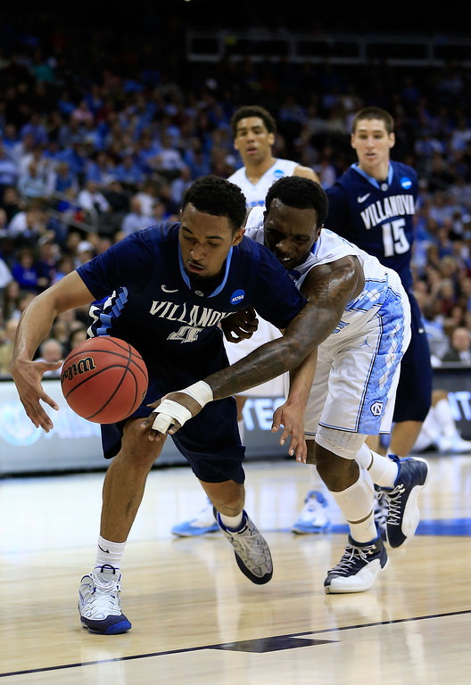 . KANSAS CITY, MO - MARCH 22: P.J. Hairston #15 of the North Carolina Tar Heels tries to steal the ball from Darrun Hilliard #4 of the Villanova Wildcats in the first half during the second round of the 2013 NCAA Men\'s Basketball Tournament at the Sprint Center on March 22, 2013 in Kansas City, Missouri.  (Photo by Jamie Squire/Getty Images)